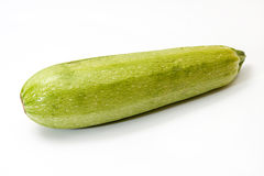 Fresh green zucchini on a white background Royalty Free Stock Photos