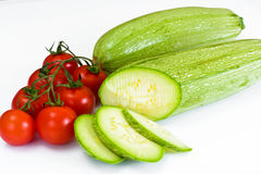 Fresh Green Zucchini on White Background Stock Images