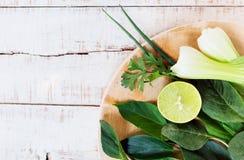 Fresh greenery on cutting board Stock Image