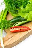 Fresh greens with chili pepper Royalty Free Stock Photo