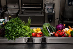 Fresh greens in metal bowl on professional kitchen. Selective fo. Cus. Shallow depth of field Stock Photo