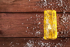 Fresh grilled corn cob with salt on wooden table. Copy space, top view Royalty Free Stock Photography