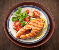 Fresh grilled salmon steak slice stock photo