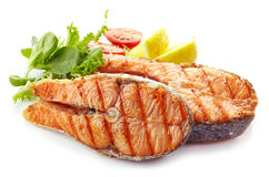 Fresh grilled salmon steak slices royalty free stock photos