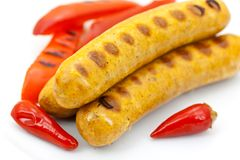 Fresh grilled sausages with red bell pepper Royalty Free Stock Photos