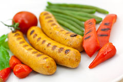 Fresh grilled sausages with red bell pepper royalty free stock photo