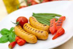 Fresh grilled sausages with red bell pepper Stock Photo