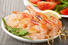 Fresh grilled shrimps. With lemon on white plate Stock Images