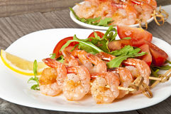 Fresh grilled shrimps. With lemon on white plate Stock Photo