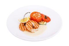 Fresh grilled shrimps with tomato. Isolated on white Royalty Free Stock Photography
