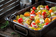 Fresh grilled tasty potato with garlic, rosemary and tomatoes Royalty Free Stock Photography