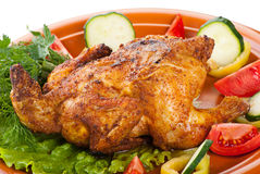 Fresh grilled whole chicken with vegetables Royalty Free Stock Images