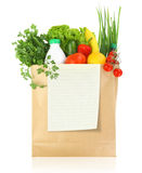 Fresh groceries. In a paper bag Royalty Free Stock Photos