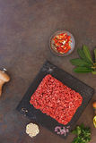 Fresh ground beef and seasonings Royalty Free Stock Images