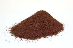 Fresh ground coffee. Pile of fresh ground Italian coffee isolated on white background stock photography