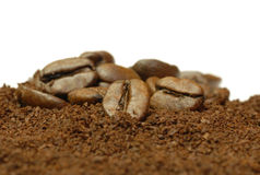 Fresh ground coffee. Coffee beans and fresh ground coffee on white background Stock Photography