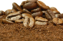 Fresh ground coffee beans. Fresh ground coffee and coffee beans on white background Royalty Free Stock Images