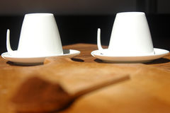 Fresh ground coffee with wooden spoon and two white cups Royalty Free Stock Image
