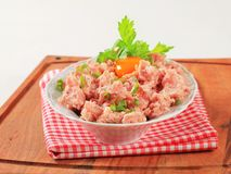 Fresh ground meat. And egg yolk in a bowl Royalty Free Stock Images