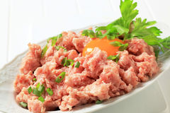 Fresh ground meat. And egg yolk in a bowl Stock Photos
