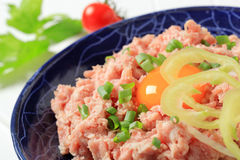 Fresh ground meat. And egg yolk in a bowl Stock Photo