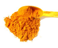 Fresh ground turmeric over white background Stock Image