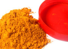 Fresh ground turmeric over white background Stock Photo