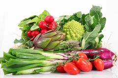 Fresh group of vegetables on white background. A fresh group of vegetables on white background Royalty Free Stock Images