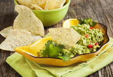 Fresh guacamole with corn tortilla chips Royalty Free Stock Photography