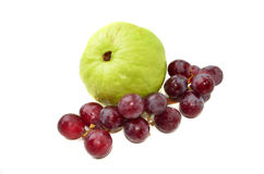 Fresh guava with red grapes Royalty Free Stock Image