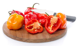 Fresh habanero peppers on cutting board Royalty Free Stock Images