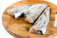 Fresh hake fish on the wooden board.  Stock Photos