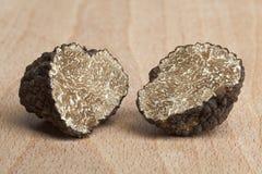 Fresh half black truffles Stock Image