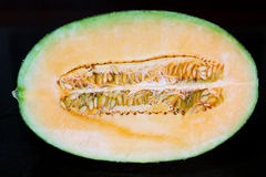 Fresh half cantaloupe. Royalty Free Stock Photography