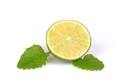 Fresh half of citrus lime with mint leaves. Royalty Free Stock Photos