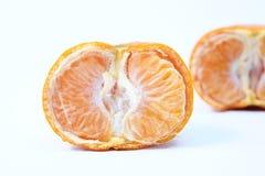 Fresh half cut orange, one sliced orange behind it. Isolated in white background royalty free stock photo