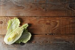 Fresh half Head Chinese salad. Peking, pe-tsai cabbage on a wooden rustic background. top view. flat layer; copy space Royalty Free Stock Photos