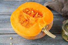Fresh half pumpkin on the boards Stock Image