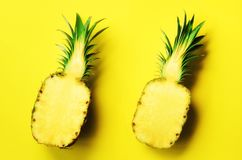 Fresh half sliced pineapple on yellow background. Top View. Copy Space. Bright pineapples pattern for minimal style. Pop Royalty Free Stock Photography