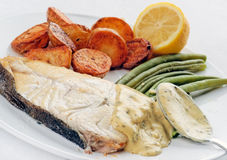 Fresh Halibut steak with Bearnaise sauce Stock Photos