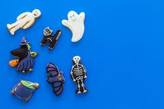 Fresh halloween gingerbread. Icing cookies in shape of halloween evils like black cat, skeleton, bat, ghost, witch on royalty free stock photo