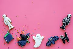 Fresh halloween gingerbread. Icing cookies in shape of halloween evils like black cat, skeleton, bat, ghost, witch on stock image