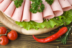 Fresh ham slices with lattuce and cherry tomato Royalty Free Stock Image