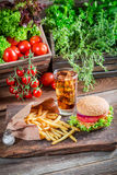 Fresh hamburger with cold drink and fries Royalty Free Stock Image