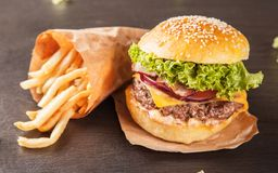 Fresh hamburger with french fries on black stone Royalty Free Stock Photos