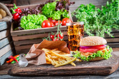 Fresh hamburger with fries and cold drink Royalty Free Stock Image