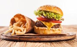 Fresh hamburger with fries isolated on white Stock Images