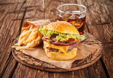 Fresh hamburger with fries served on wood Stock Image