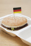 Fresh hamburger with German flag decoration on wooden surface Stock Photography