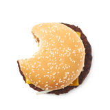Fresh hamburger isolated. Fresh cooked hamburger with a single bite taken, composition isolated over the white background Royalty Free Stock Photography